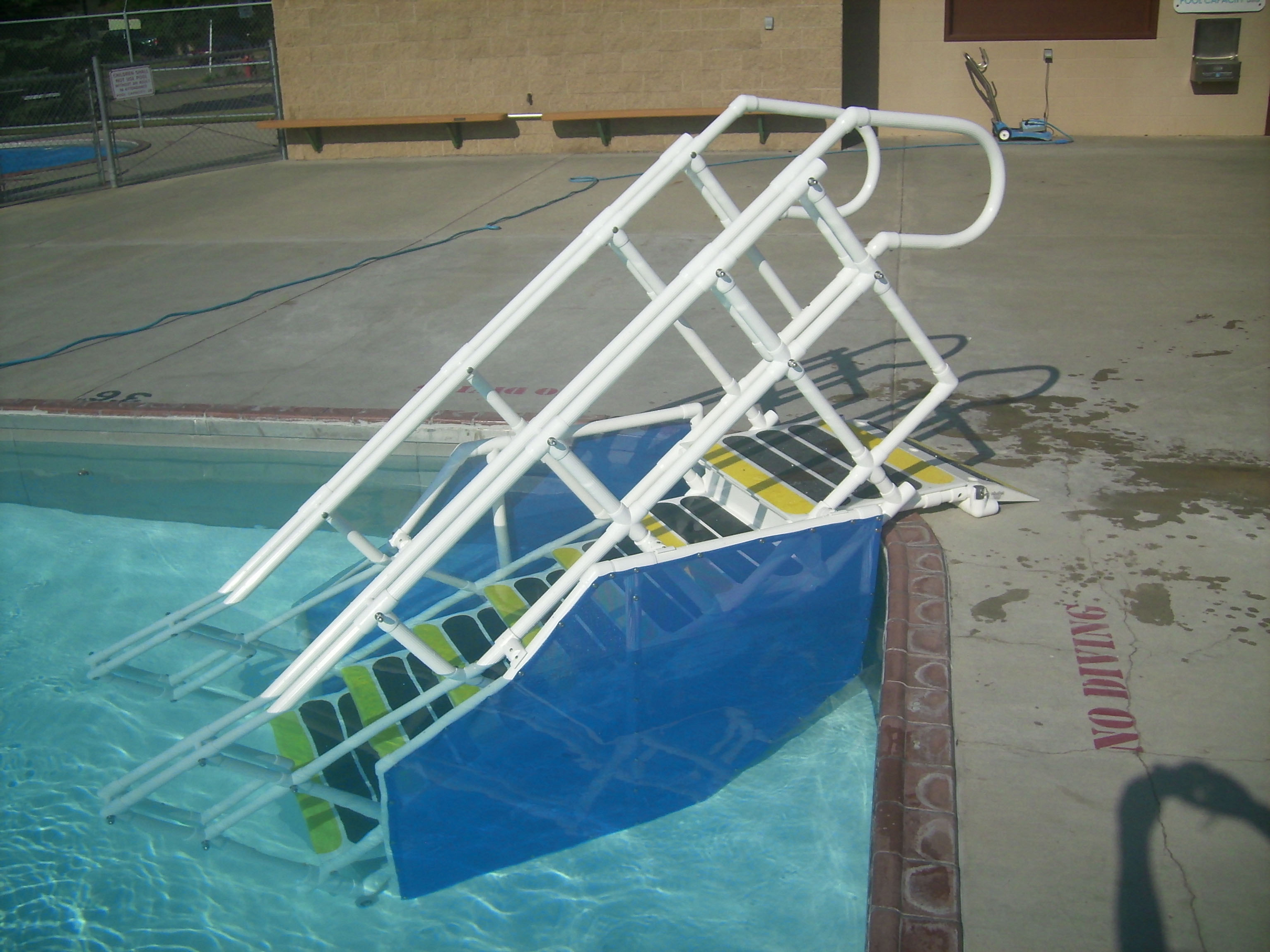 ADA pool steps side